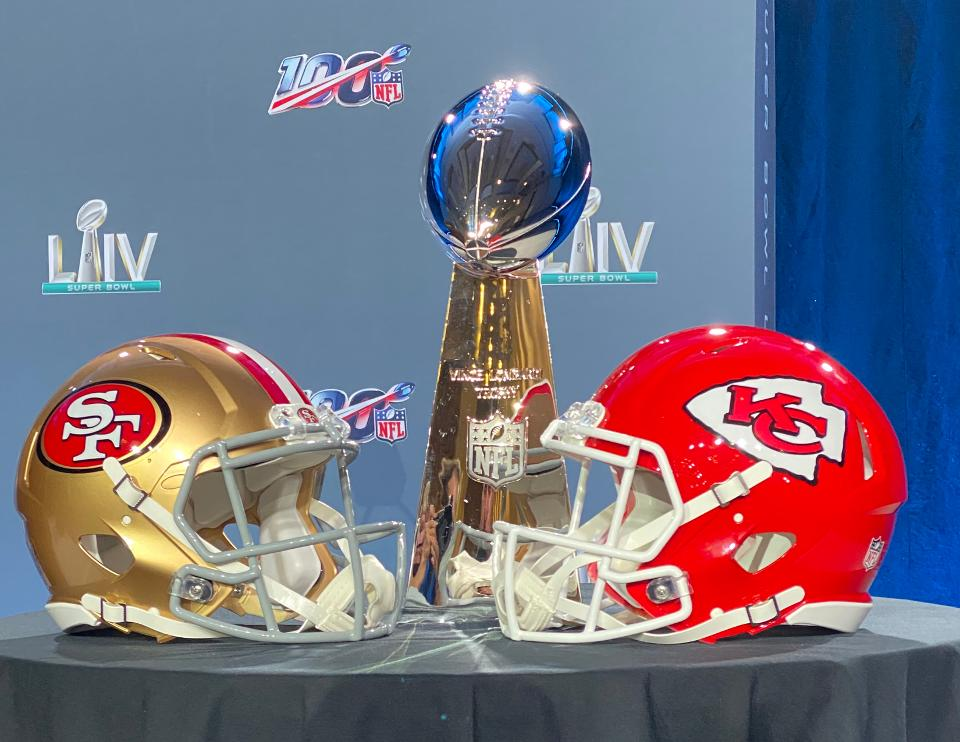 49ers and Chiefs helmets with the Lombardi Trophy